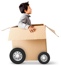 Boy in a car made of cardboard box - express delivery concepts-1