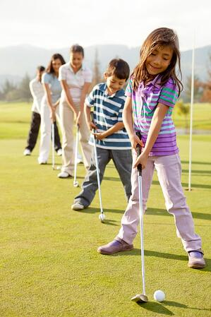 Golf players practicing to hit the ball