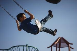 kid swinging
